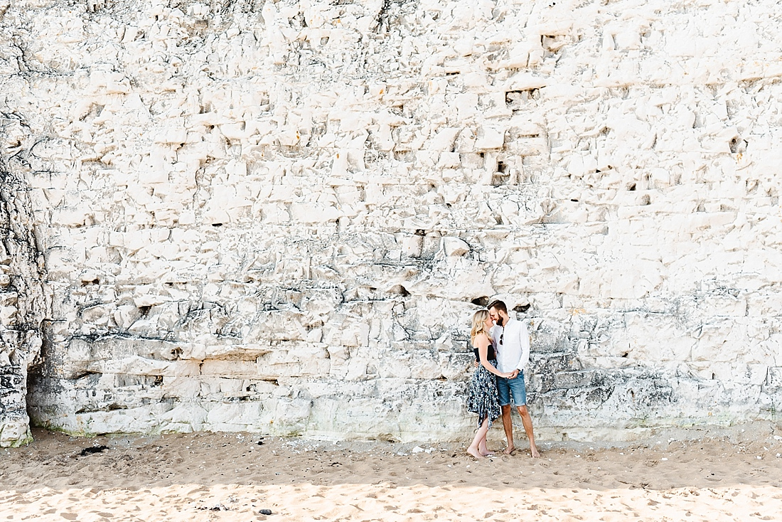 Kissing by the cliffs engagement