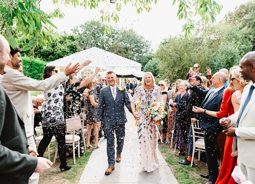A colourful outdoor wedding at Sanctum On The Green with a Temperley wearing bride