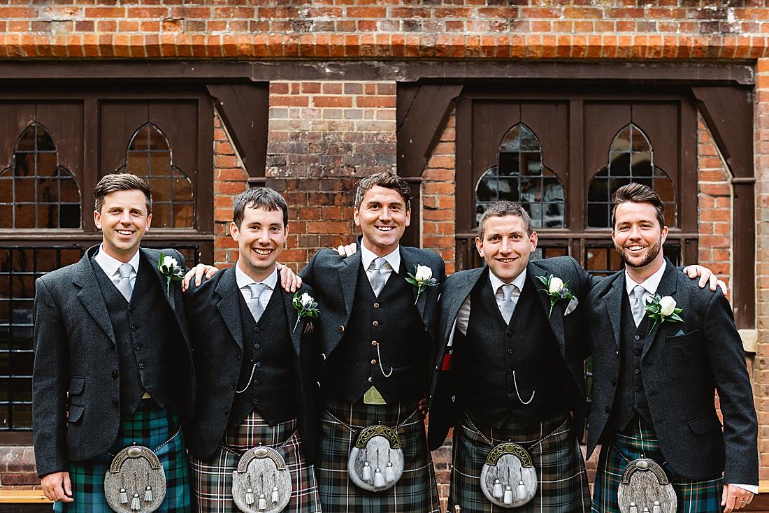 Men in kilts Scottish wedding in Surrey