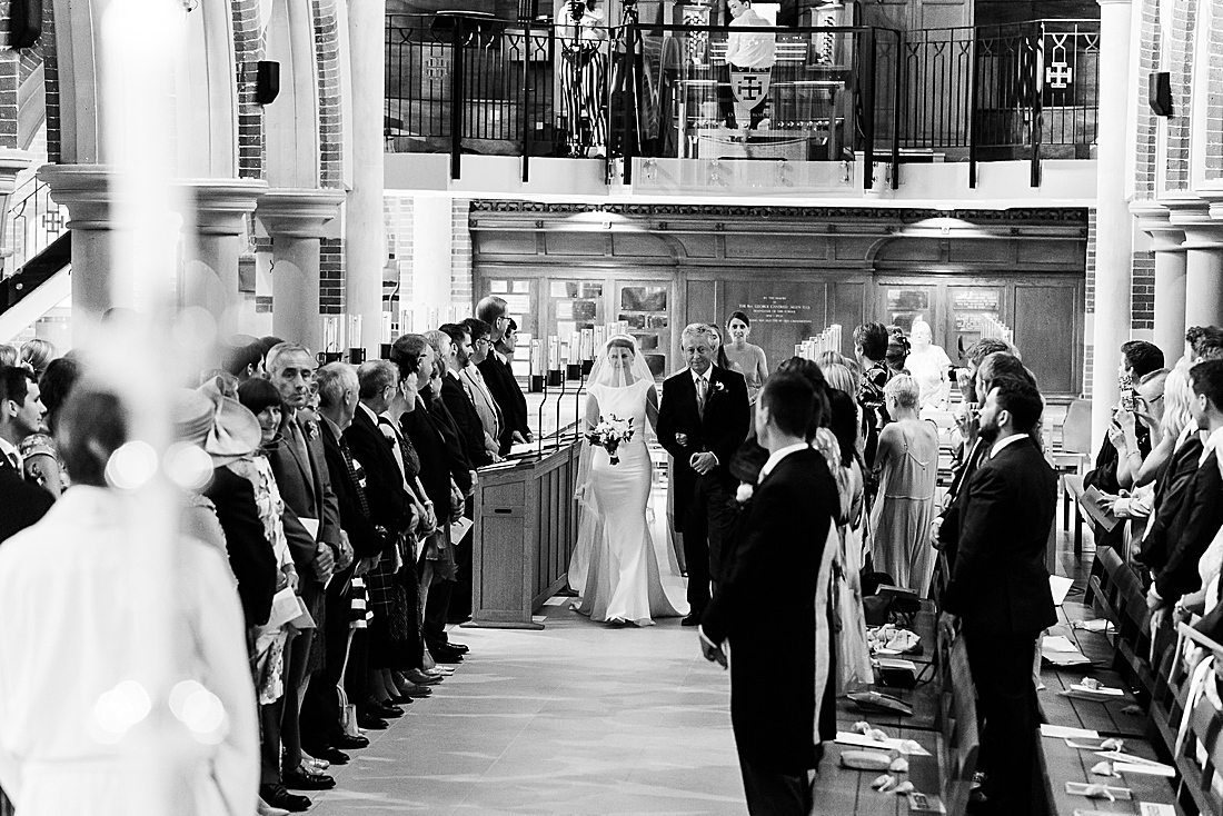 Bride walking down aisle Surrey wedding Fiona Kelly Photography