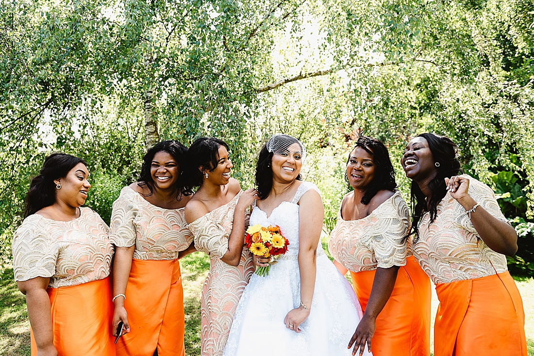 Bridesmaids in orange London wedding © Fiona Kelly Photography