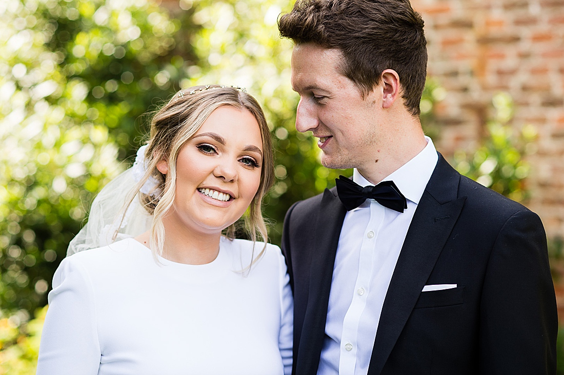 Black tie wedding in the gardens at Saltmarshe Hall in Yorkshire
