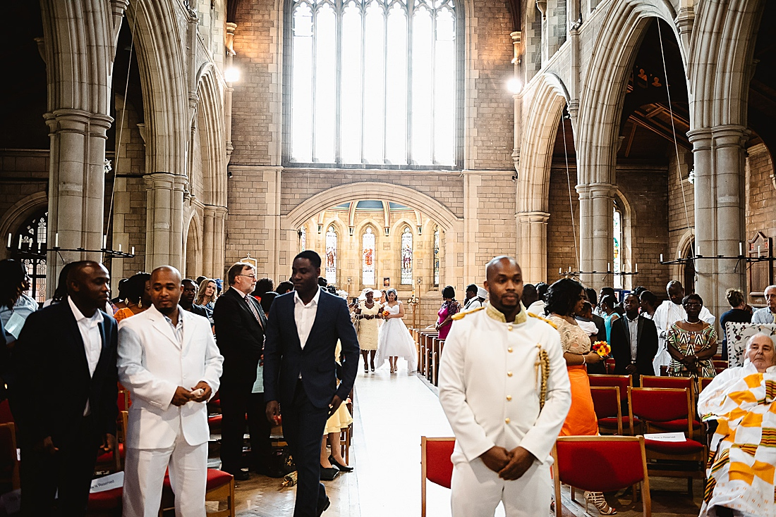 African groom in white suit Enfield wedding photography © Fiona Kelly Photography