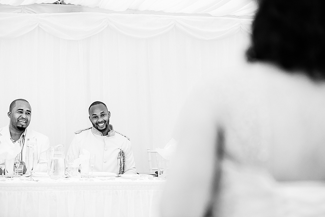 groom in white African wedding London © Fiona Kelly Photography