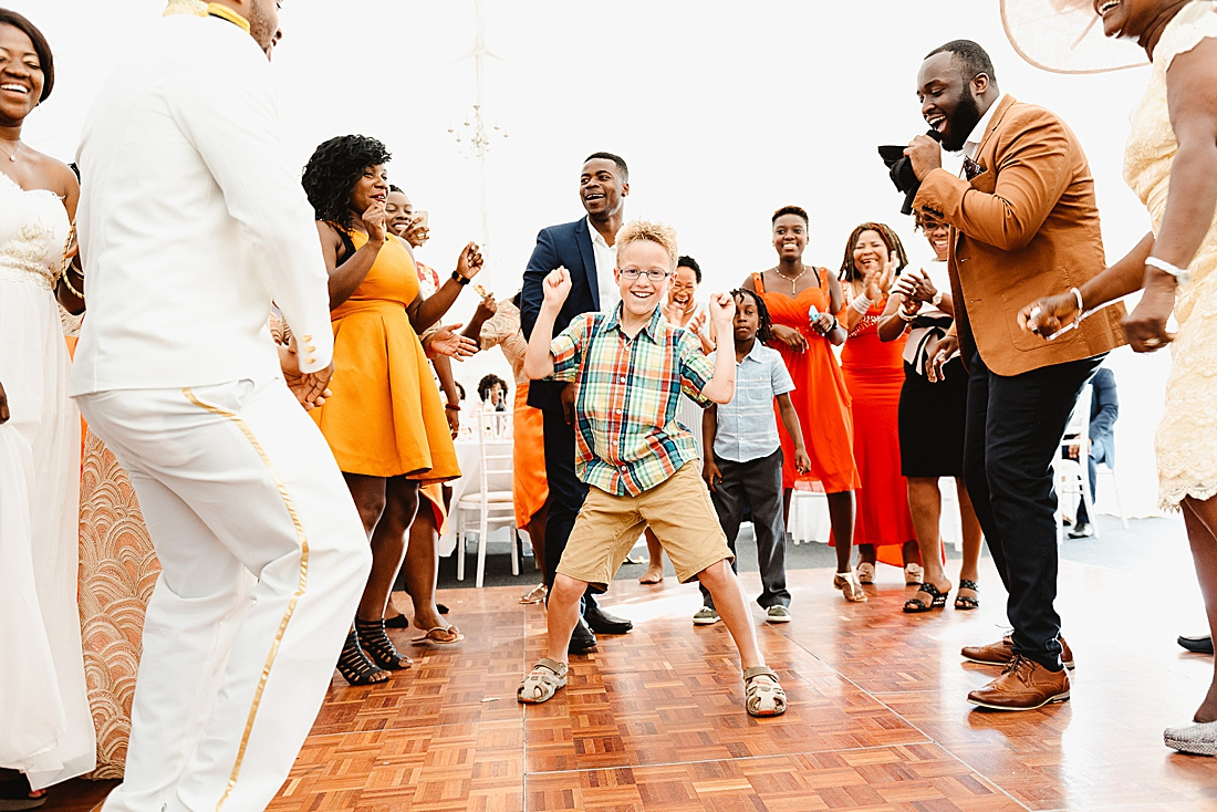 Orange wedding theme lively dancefloor © Fiona Kelly Photography