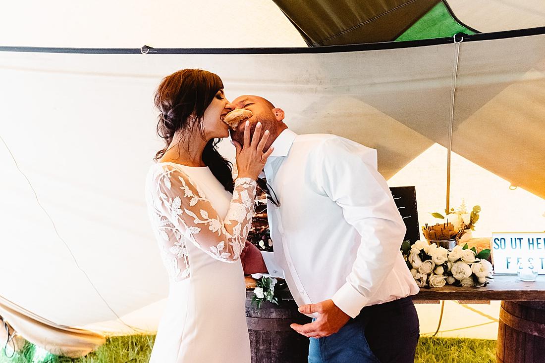bride and groom eat doughnut festival wedding Hertfordshire