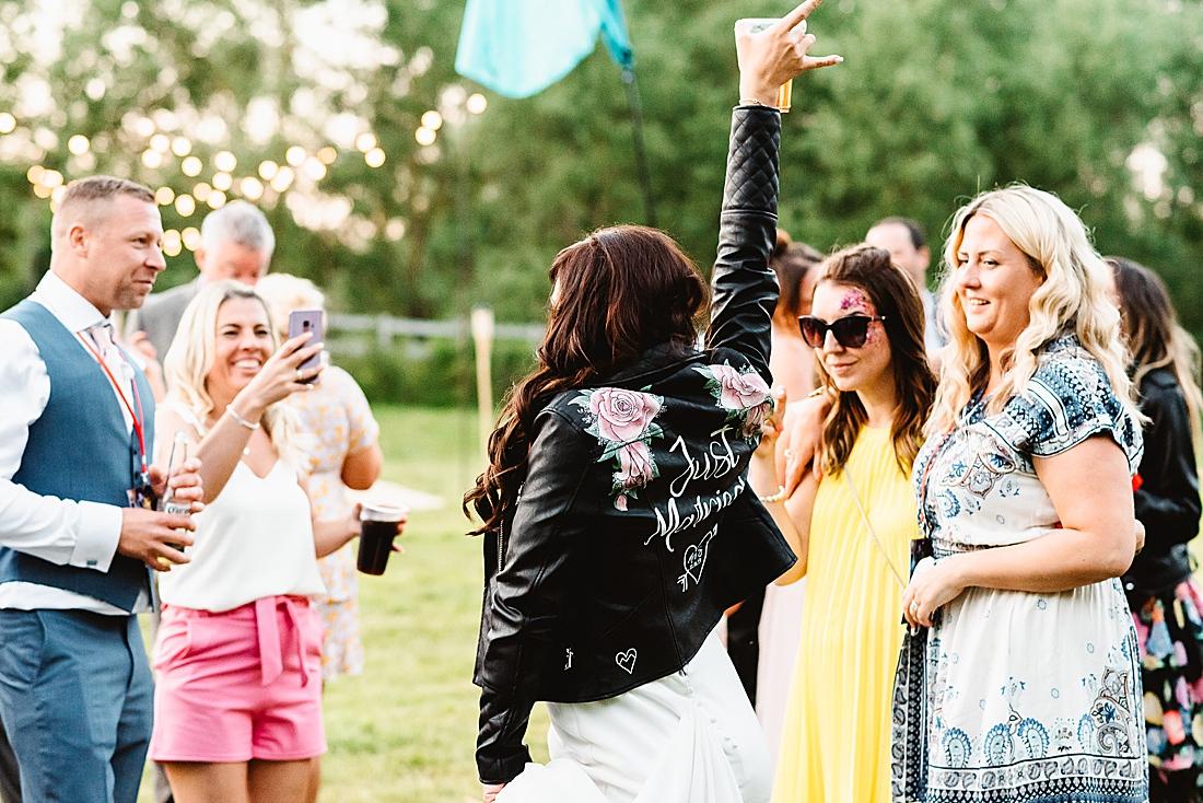 bride leather jacket festival wedding Hertfordshire