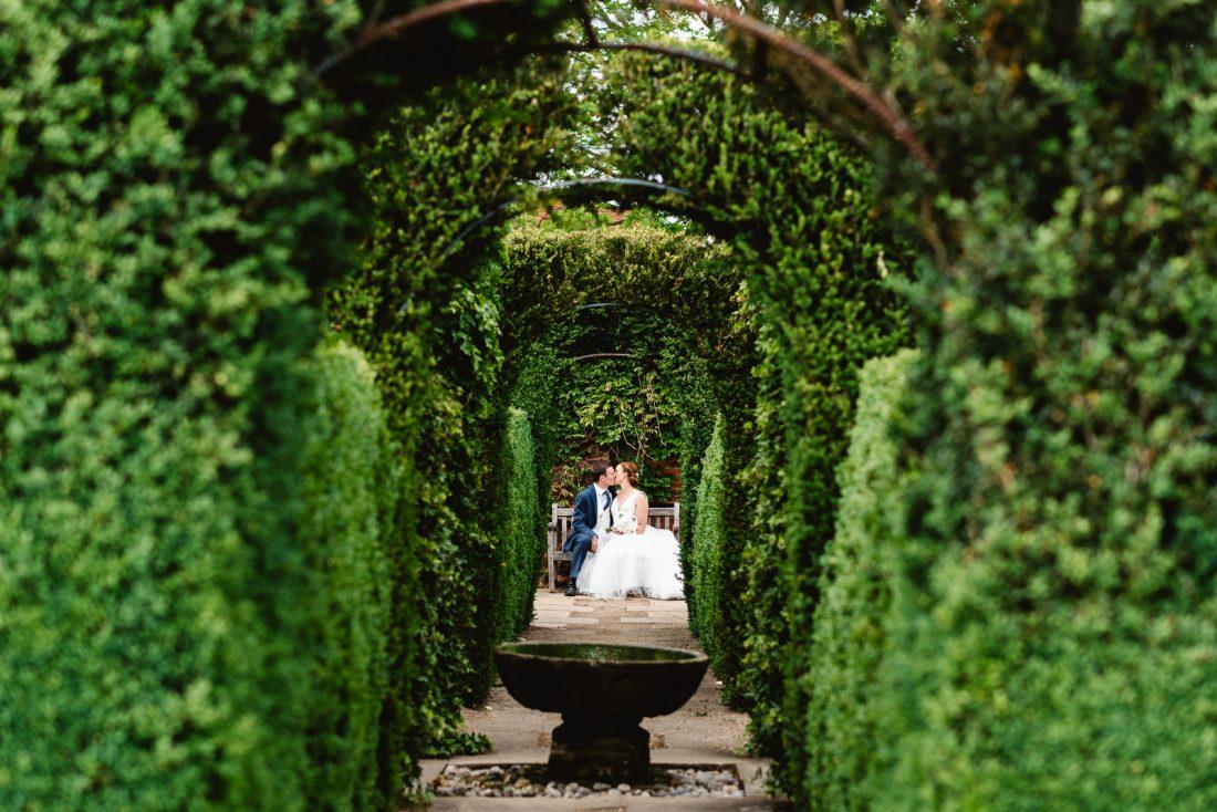 bride-groom-kissing-garden-hatfield-house