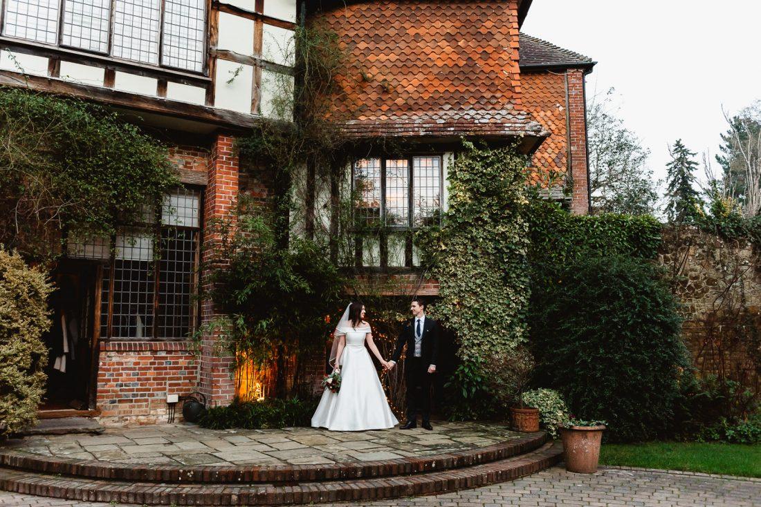 winter-wedding-ramster-hall-bride-groom-outside