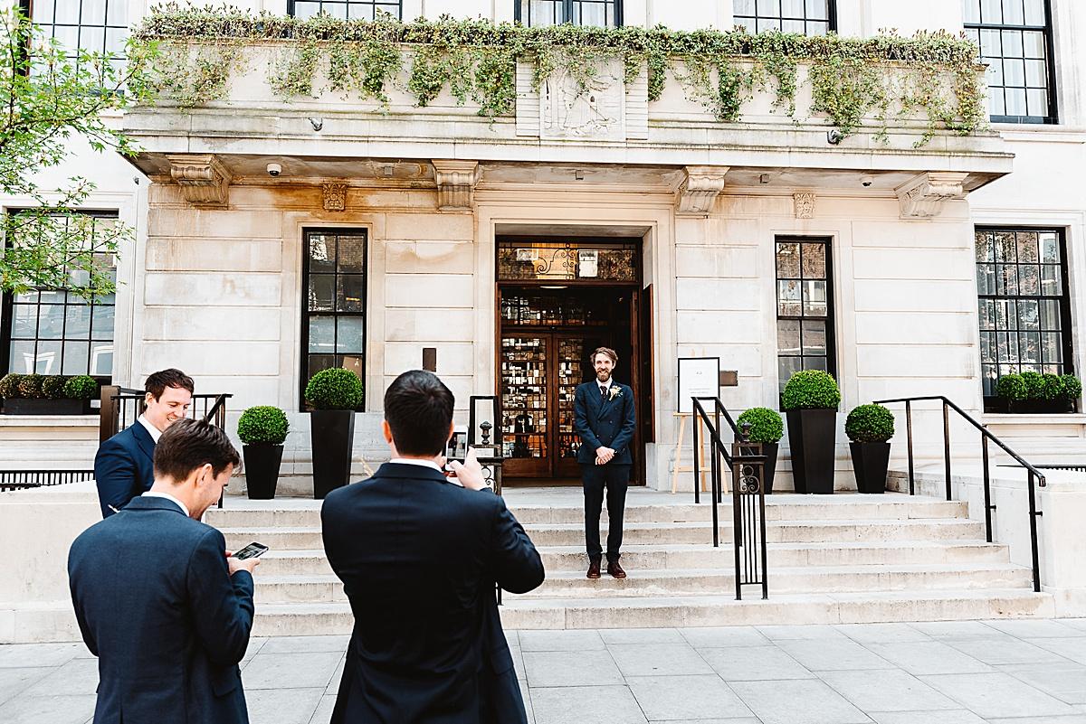 Town Hall Hotel wedding groom on steps
